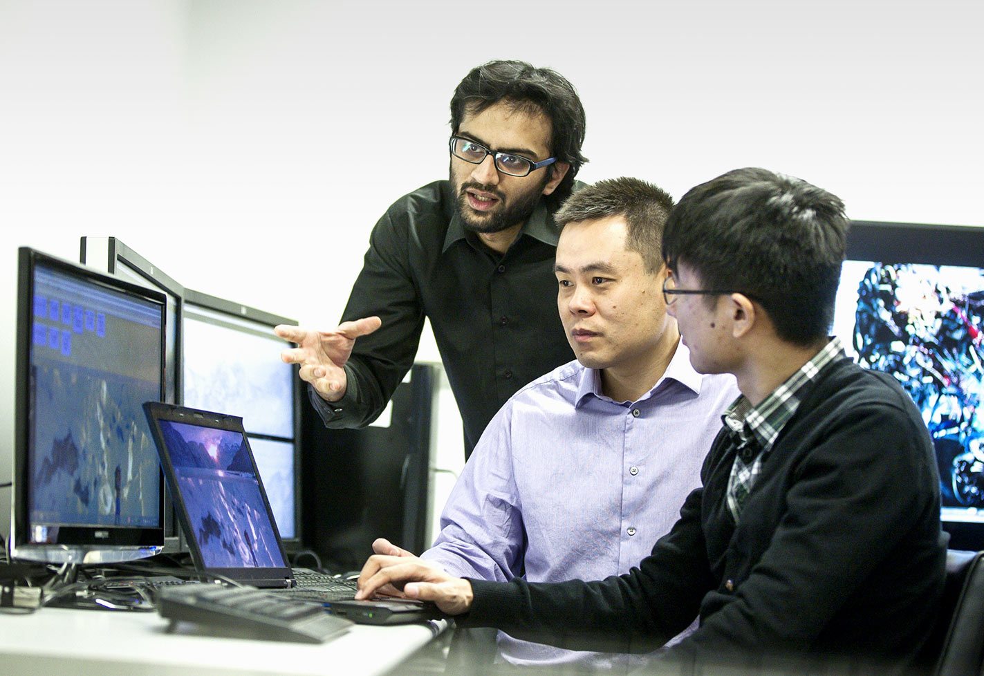 Dr Abdul Rehman, Dr Zhou Wang and Student in Video Lab at the University of Waterloo Assessing Video Quality of Experience