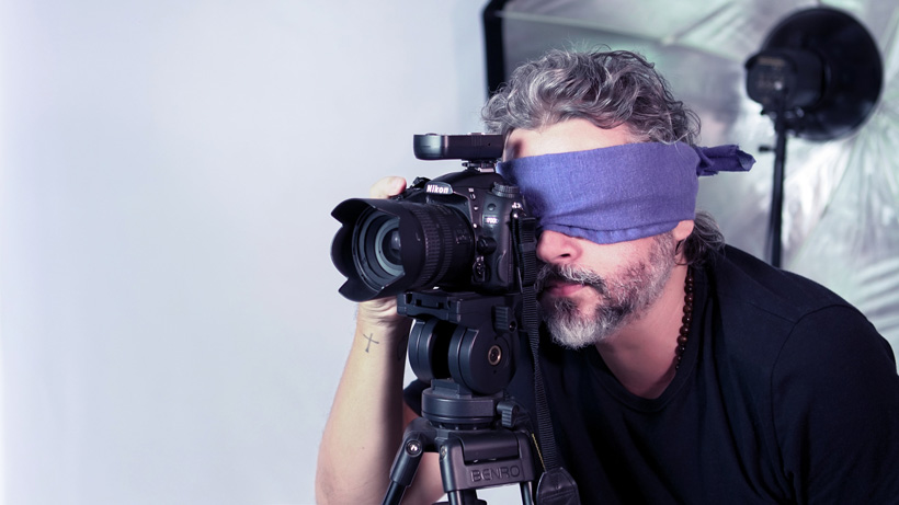 camera man looking through camera lenses