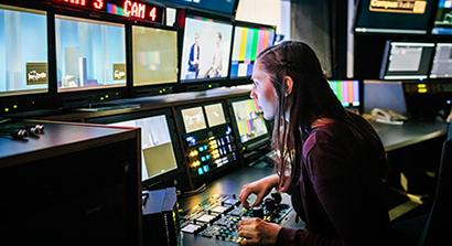Woman Using TV Studio Equipment